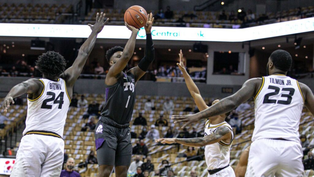 Horned Frog basketball player Mike Miles takes a shot against the SEC team, Missouri during a Big 12/SEC match-up.