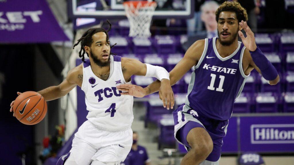 tcu basketball player dribbles basketball around k-state player