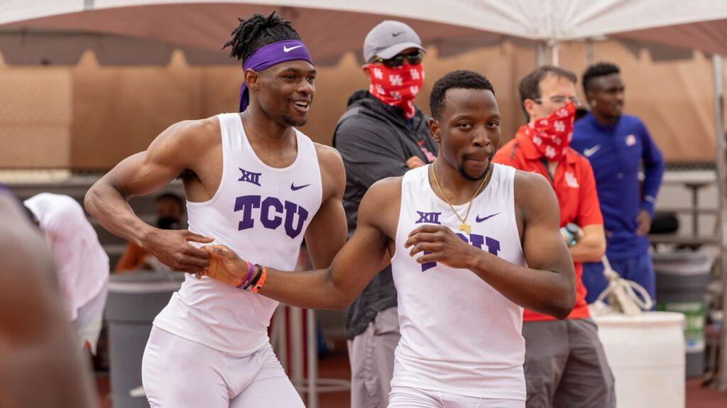 Tinotenda Matiyenga and Robert Gregory Jr. give each other a handshake during an outdoor track meet.