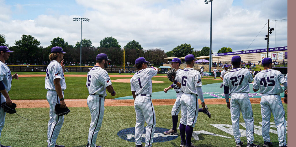 tcu baseball players give each other high fives during a season game