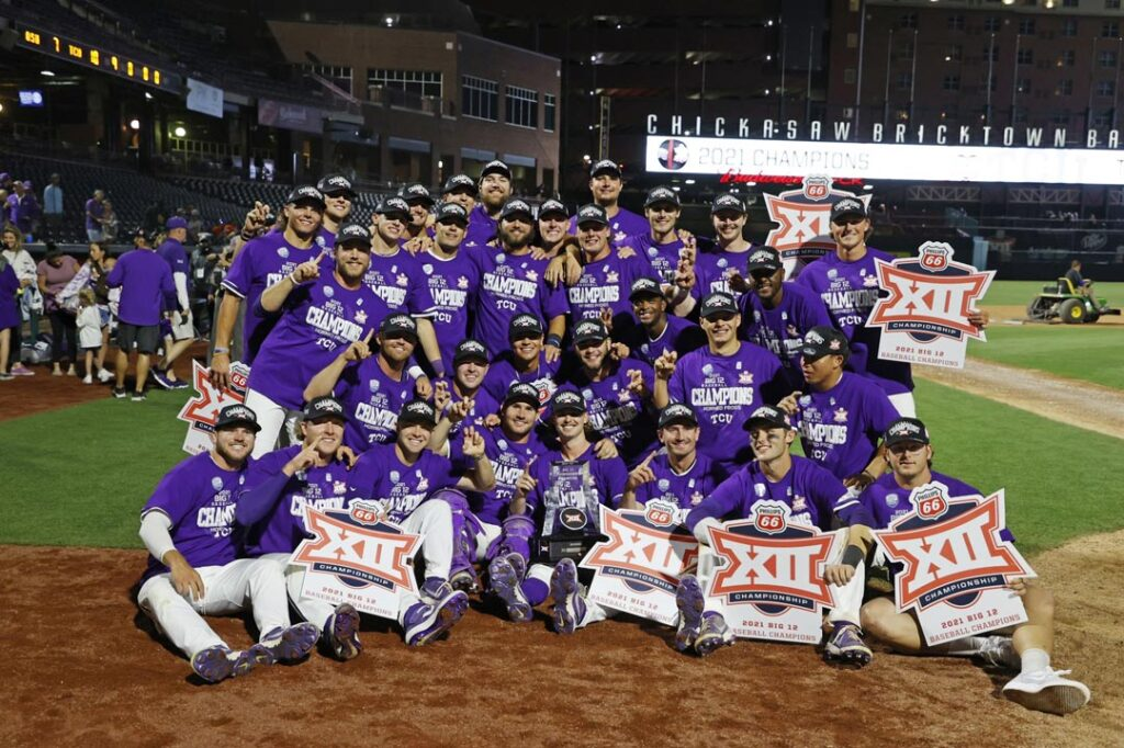 the whole tcu baseball team poses on the field in OKC after winning the 2021 season Big 12 tournament